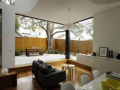 Vista de sala con terraza de casa pequeña dos pisos