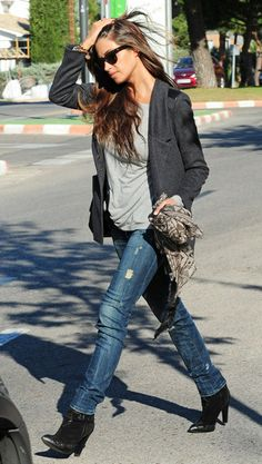 Sara Carbonero in grey blazer, distressed jeans, grey t-shirt, and black Mango ankle boots.