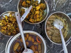 (clockwise from bottom) pointed-guard and potato curry, cauliflower-potato side, pointed-guard and potato side, mixed vegetable stew
