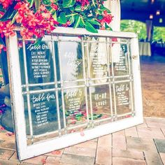 Window-painted seating charts: essential for a vineyard wedding  To see more of this beautiful #BridesRealWedding, click the link in profile | : Amy Galon Photography : @smashweddingsandevents : @gervasivineyard