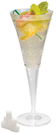 French 76: Cointreau, Vodka, Champagne, and a fruit garnish