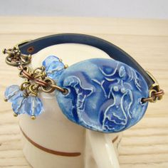Blue mermaid bracelet, ceramic siren, leather, mixed metals, Czech glass beads by laurelmoonjewelry, $24.00