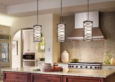 Remodeling Kitchen Lighting When hanging pendant lights over a kitchen island, like these Corporate Krasi pendants, the pendants should be hung inches above the island surface. Kitchen Interior, Hanging Light Fixtures, Kitchen Fixtures, Kitchen Remodel, Kitchen Pendant Lighting, Kitchen, Kichler Lighting, Hanging Lights Kitchen, Pendant Light Fixtures