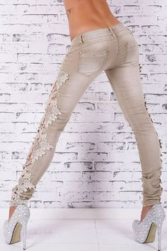 the denim pants featuring slim fit design. zip fly with snapper closure. hollow out lace paneled.