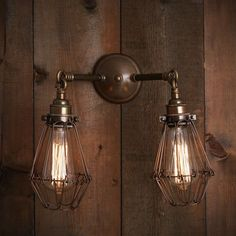 This Rigo double arm cage WALL LIGHTING is designed and manufactured in Ireland, It looks fantastic when lit with Edison filament bulbs and is suitable for use in any modern industrial style interior.