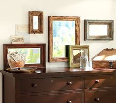 Eclectic Chippy Mirrors #potterybarn  I think all these mirrors would look great above my couch.