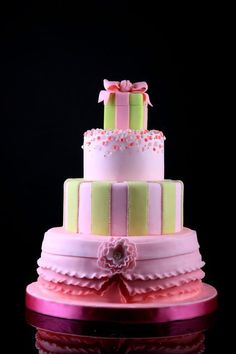 pink and green birthday cake - mom white and blue and green :)
