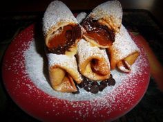 """Dulce de Leche and Chocolate Chip Chimichangas - Hispanic Kitchen..(5 ingredients!)..""""I cannot say enough of about this mini dessert chimichanga recipe! If you prepare this for your friends, they are going to believe you purchased them from a fancy bakery... no kidding. Just a few simple ingredients combined with flour tortillas and you have a  great Mexican inspired dessert that everyone will love."""""""
