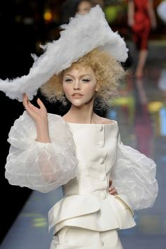 Christian Dior 13/25 hahahah this isn't supposed to be funny but she looks like she's from the Capitol