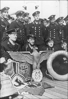 The crew of one of the sunken destroyers at Narvik with saved insignia of their ship. June,July. (1940)