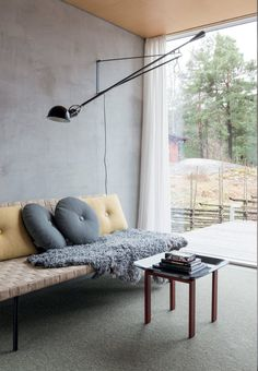 Living room with a daybed from Ikea designed by Ilse Crawford with pillows from Hay.