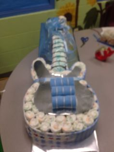 Diaper guitar cake made with 4 receiving blankets , three each cloths  and 72 size two diapers. and a little creativity! Enjoy