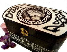 This box is adorned with my Celtic Wolf design on the top and Celtic knot work around the sides. The original design was done in pen and ink