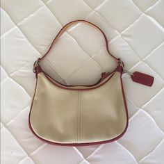 Coach Handbag Authentic small Coach handbag. Solid tan fabric with red leather accent. Light blue lining with inside zip pocket. EUC Smoke free home. Coach Bags Mini Bags