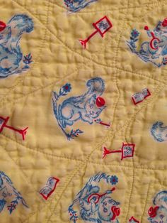 Vintage crib quilt- pale yelliw and ble