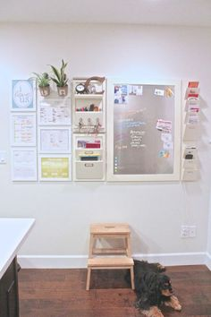 The first thing to keep in mind when building a family command center? Make a place for everything.  And we mean everything. Valerie at The Caldwell Project has a spot for letters, scribbled notes, the weekly dinner menu, and even two plants! But choosing a white and pastel color palette keeps the command center from overpowering the room. Click through for more on this and other family command center ideas perfect for the back-to-school season.