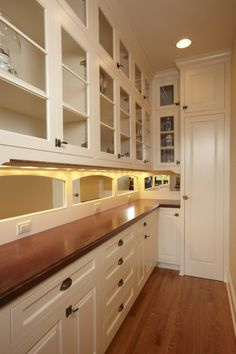 re-use MBR sliding closet doors as back wall of new pantry closet  eclectic kitchen by John Kraemer & Sons