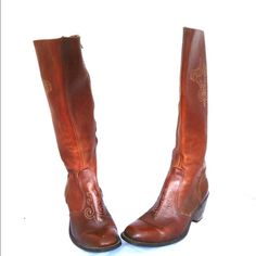 """Leather Cowboy Boots Wood Wrangler 8.5 Wrangler vintage supple, cognac colored with golden stitched details.   Beautiful, well made and lovingly cared for leather, made in US.   These boots are very comfortable with wood stacked heels and zip up with metal zippers on the inside   Era: 70s Size: 8.5 (marked size 9M better fit for 8.5) Euro: 40  Measurements:  2.5"""" Heel 16.5"""" high from ball of foot bed to top of boot 18"""" around calf  Condition: Very good condition with a few scuffs and a…"""
