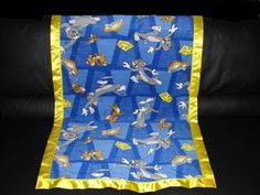 This Fleece blanket has Tom & Jerry on it and is made from 100% Polyester Fleece with a two inch satin trim around the blanket (all our blanket trims and fleeces are 100% Polyester). We will personalize the blanket which is included in the price with the person's first name (embroidery letters are about 2 inch tall). We are in no way a sponsor or affiliated with the licensee or manufacturer. We Guarantee Quality in our blankets. Thank you for your Business.
