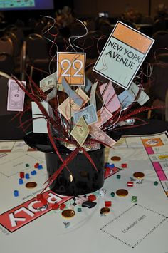 Monopoly Centerpiece.  This would be really cool for the table assignements