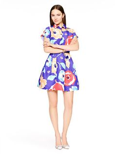 one doesn't usually think of shirtdresses as sexy, but this one--belted, in blossom-covered blue, and boasting an abbreviated hemline--certainly has a soupcon of oomph. wear it buttoned-up with a pair of flat sandals to keep the overall effect subtle, or add a pair of sky-high heels to play it up.