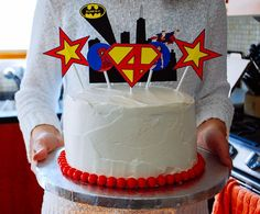 Easy super hero birthday cake idea for a super hero birthday party. Download these free printable cake toppers!