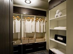 A luxurious apartment amenity, the walk-in closet offers storage drawers, overhead cabinetry, open shelving, hanger space and portable tea-stained rattan-peel storage baskets.