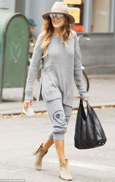 Keeping it casual: pair of loose fit sweatpants with smiley face symbols on either leg with a long knitted sweater