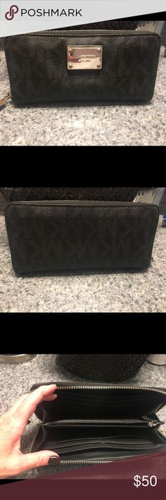 a48665f54679 Michael Kors large black wallet Large wallet that zips close. Lots of room!  Silver emblem has a few minor scratches.