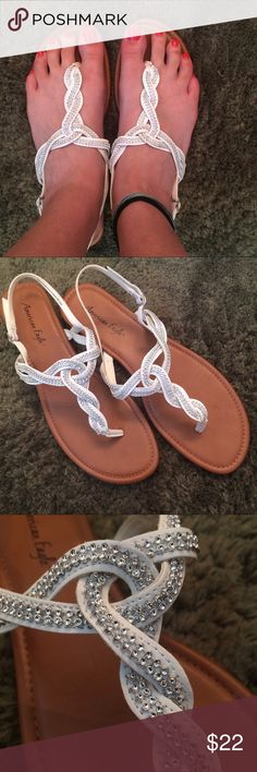 Beach wedding sandals White and silver size 12 strappy sandals. Worn once for my wedding ceremony and then immediately taken off, cuz if you can be barefoot in Kauai why wear anything? Bottoms have a little wear from forest and sand, but the top parts are in perfect condition. Please see zoomed in picture for silver detailing, NOT rhinestones American Eagle by Payless Shoes Sandals