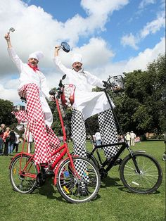 French Chefs for any event including corporate events #Bicycle #Walkabouts #Stilt-walkers Stilt walker on bicycles #Chef stilt walkers