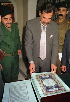 A copy of Quran was written with Blood of Saddam Hussain. It became controversial after his death because it is considered sin to write Quran in blood and so is destroying it. Iraqi President, Iraqi Military, Young Johnny Depp, Princess Diana Family, Saddam Hussein, World Of Books, Baghdad, Book Signing, World Leaders