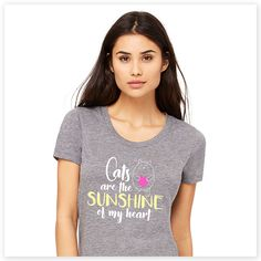 """When you're a cat lover, everything about them makes you happy. This adorable """"Cats are the Sunshine of My Heart"""" tee sums that sentiment up purr-fectly. Super-soft, ultra-comfortable shirt in a heather grey color is made of 50% poly, 25% combed and ring-spun cotton and 25% rayon. Design exclusive to Zee & Zoey's Cat Creations!"""