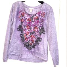 Floral graphic print top Long sleeve top with a floral and stripes graphic print on the front. It is a lavender/cool gray color. There is very minimal pilling and light dime sized stain on one sleeve. Both are hardly noticeable unless examining up close. 100% polyester. Weavers Tops Tees - Long Sleeve