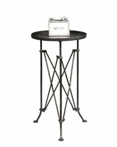 Industrial Look Small Metal Round Table 14.5 Inch Diameter by Touch of Europe. $49.99. Nice for a side or occasional table. Ships as oversize package to street address. 14.5 inches in diameter, and 25 inches high. This table is 14.5 inches in diameter, and 25 inches high, so it would make a nice side table, or occasional table. Ships as an oversize package to a street address.