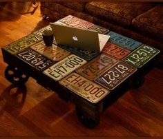 License Plate Coffee Table- this would be cool in the boys bedroom to cover their ugly bedside tables/nightstands.