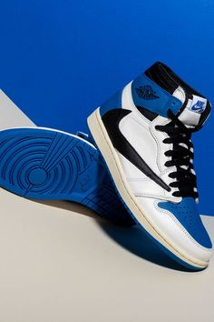 Three of the most creative forces in sneakers, Hiroshi Fujiwara, Travis Scott, and Jordan Brand, come together on an Air Jordan 1 that combines the aesthetics of each entity while staying true to the model's timeless design. Jordan 1 High Og, Jordan 11, Wings Logo, Travis Scott, Timeless Design, White Leather, Air Jordans, Stockings, Footwear