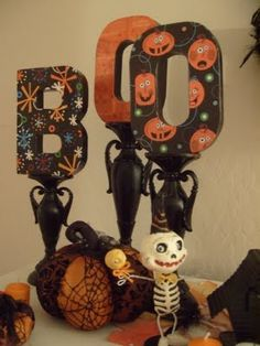 Halloween decor: Painted letters on candle sticks!