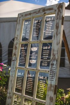 This unique vintage door has 15 beautiful panes perfect to write your seating assignments for a wedding. My husband and I add hinged legs on the back to help it stand in the grass at our wedding. You can see this in the picture. We had 18 tables at our wedding and added 4 panes …