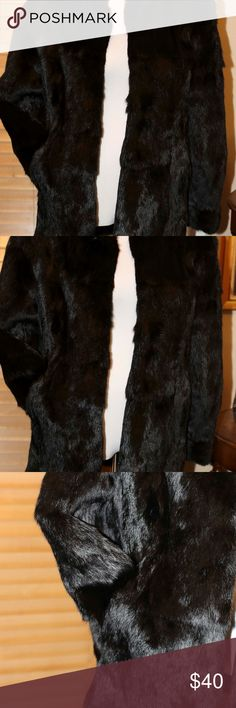 Black Rabbit Fur Coat Circa late '80s Healthy look This black rabbit coat was purchased for my 40th birthday for an outing in New Orleans to see the play Cats, and never worn again after that.  It id very plush and warm.  I have seen no molting.  It is size small and measures Bust- under are-42 in Shoulder-18 in Length-center back from collar to hem 30 1/2 in Arm length-23in. Has a stand up collar. Two large clasps for closures. These are well hidden with the fur. No wear or tear or odor…
