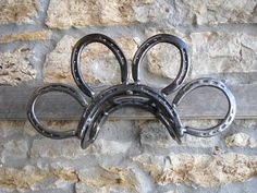 Garden Hose Holder Made from Horseshoes