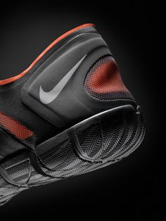 Nike shoe, fabric, rubber, black, orange