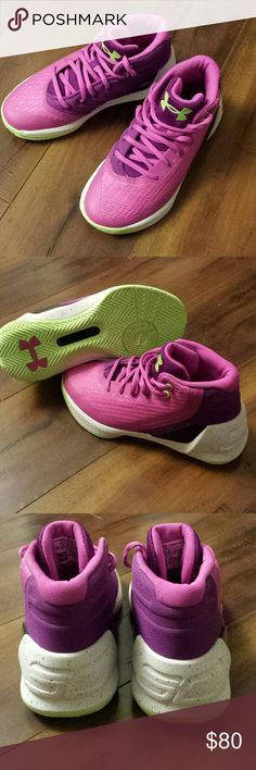 New Under Armour hightops Cute pink and purple hightops with green soles, highlights, and logo. Bought them for my daughter for basketball but it was summer when she finally grew into them so they were never used. These are new, never worn.  Curry 3 Under Armour Shoes Sneakers