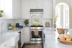 This all-white kitchen uses subway tile to reflect light, making the space feel larger that it actually is