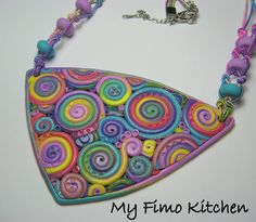 This makes me think of FMQ... I've never tried swirls...  What fun.  By My Fimo Kitchen. (No other name given.)
