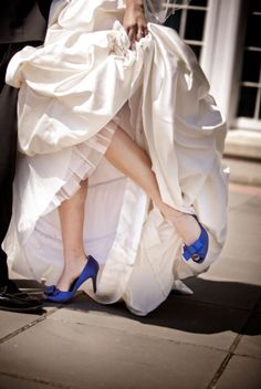 I like the surprise of the blue heels beneath the wedding dress