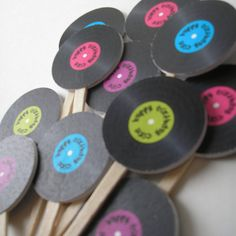 Normal sized records on sticks for the photobooth for music themed wedding