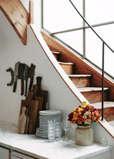 kitchen counter with decor and stairwell. / sfgirlbybay
