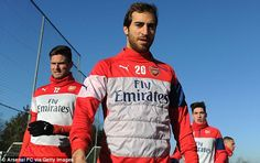 Mathieu Flamini of Arsenal comes out for the training session on Saturday with his team-ma...