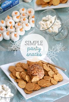 """When hosting a party for young kids, it's a good idea to keep the food simple. The partiers snacked on a cheese ball and crackers, white chocolate snowflake pretzels, and powdered doughnut """"snowmen"""" with orange Starburst noses. We also served pre-scooped (to save time!) vanilla ice cream """"snowballs"""" with silver, blue and white sprinkles, marshmallows and white chocolate chips as toppings."""